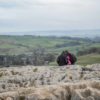 Couple enjoying the view from Malham Cove