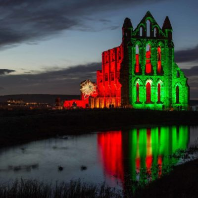 Dusk, Abbey dressed in Red & Green