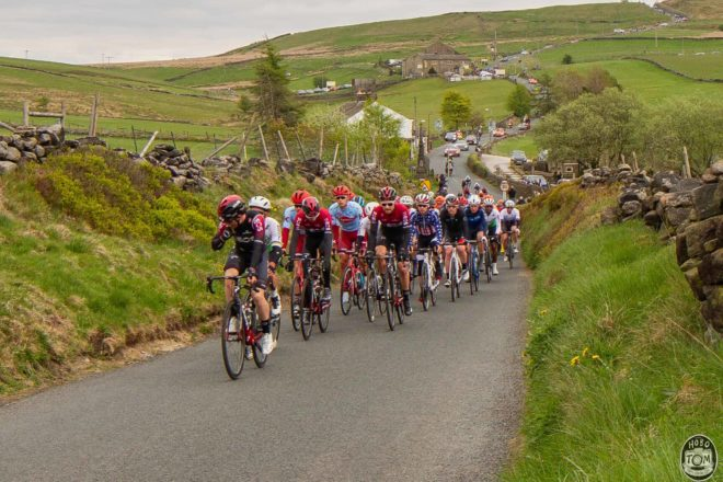 The peloton heading up Black Moor road, Oxenhope