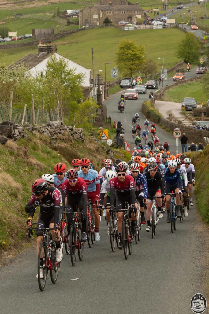 The peloton climbing Black Moor Road, Oxenhope